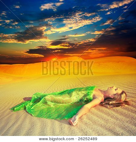 Beautiful woman sleeping in the middle of desert