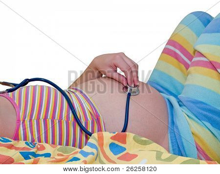 pregnant woman listening for her baby in the belly with stethoscope isolated on white