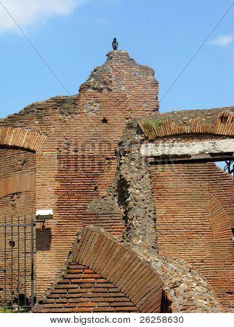 damaged brick walls in the ancient Roman city Pompeii