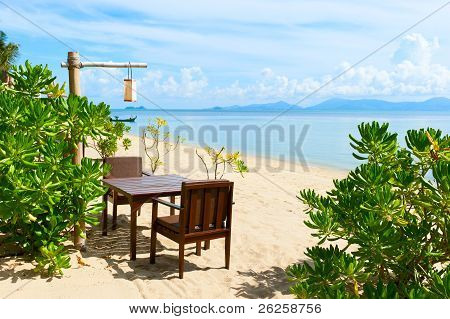 Chairs And Table On Beach Near The Sea