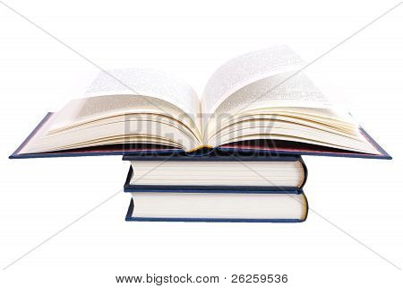 Book On Stack Of Books Against White Background.