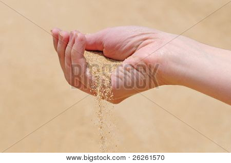 arm dropping sand