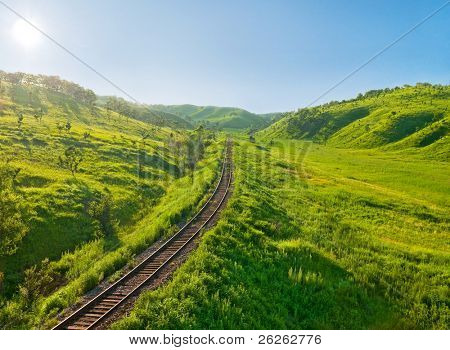 old railway track on the morning hills landscape