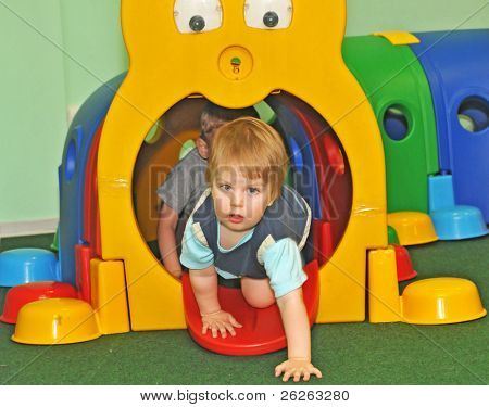 kids playing crawling in the playcentre