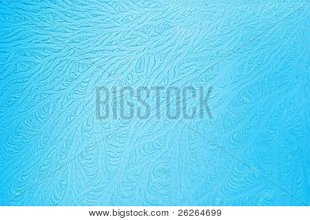tree like fractal blue ice winter decoration on a window natural background