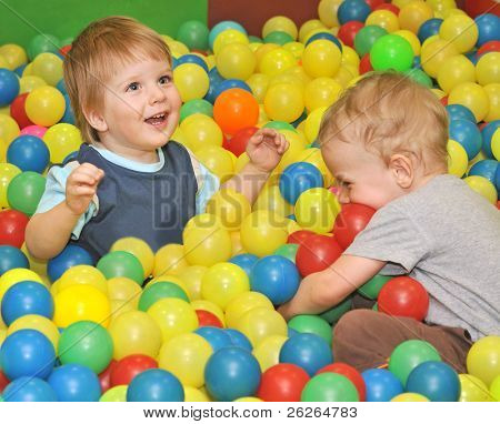 brother kids playing with colored balls