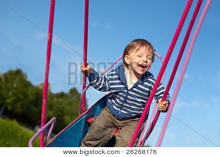 laughing baby on the swing