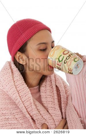 Woman Sipping A Hot Of Coffee