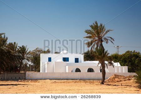 White house in arabic style on Djerba, Tunisia