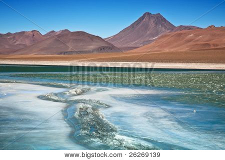 Diamond lagoon in Atacama desert, Chile, focus on the cracked ice