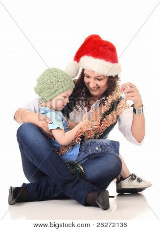 Girl In A Santa Hat Playing With A Boy