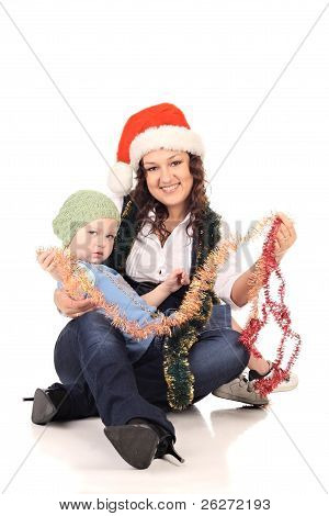 Girl In A Santa Hat With A Little  Boy