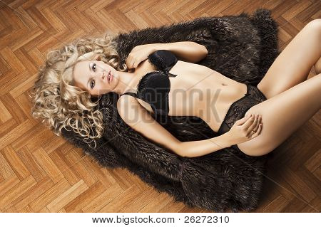 Sexy Girl In Lingerie With Fur, Her Arms Are Open, Her Right Hand Is On The Right Thig