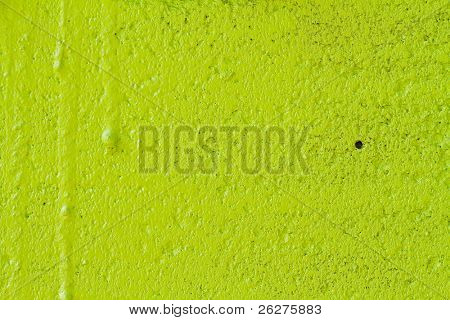 Closeup view of a painted green wall