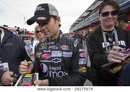 LAS VEGAS, NV - FEB 28: Jeff Gordon signs autographs before the running of the Shelby American GT 350 NASCAR Sprint Cup race at the Las Vegas Motor Speedway on Feb 20 2010  in Las Vegas, NV