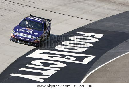 BRISTOL, TN - MAR 19: Matt Kenseth brings his Crown Royal Ford through the turns during a practice session for the Food City 500 race at the Bristol Motor Speedway on Mar 19, 2010 in Bristol, TN.