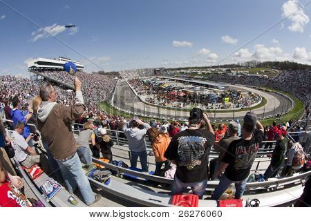 MARTINSVILLE, VA - MAR 29:  Fans listen to the national anthem for the running of the Goody's Fast Pain Relief 500 race at the Martinsville Speedway on Mar 29, 2010 in Martinsville, VA.