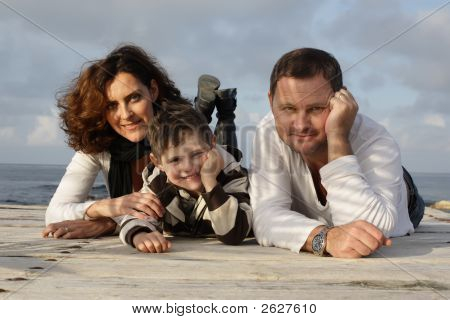 Happy Family On A Pier