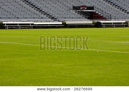 Football field with empty bleachers in the background.