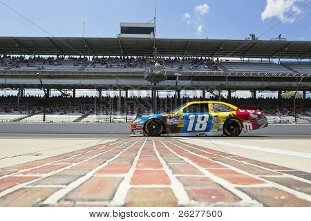 INDIANAPOLIS, IN - JULY 23:  Kyle Busch brings his M&M's Toyota across the bricks for the Brickyard 400 race at the Indianapolis Motor Speedway on July 23, 2010 in Indianapolis, IN.