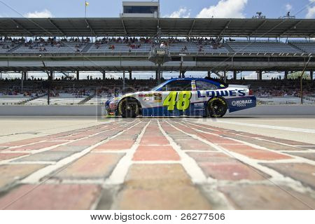 INDIANAPOLIS, IN - JULY 23:  Jimmie Johnson brings his Lowe's Chevrolet down pit road for the Brickyard 400 race at the Indianapolis Motor Speedway on July 23, 2010 in Indianapolis, IN.