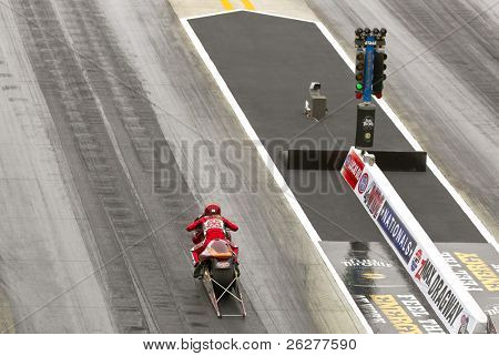 CONCORD, NC - MAR 28:  Ange Smith takes her pro stock motorcyle down the track at the zMax Dragway for the running of the inaugural Four-Wide Nationals event in Concord, NC on Mar 28, 2010