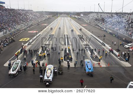 CONCORD, NC - MAR 28:  The Funny Car dragsters their stop at the zMax Dragway for the running of the inaugural Four-Wide Nationals event in Concord, NC on Mar 28, 2010