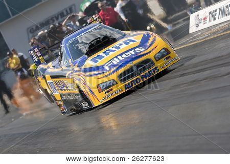 GAINESVILLE, FL - MARCH 13:    NHRA Funny Car driver, Ron Capps, brings his car down the track during the 41st Annual Gatornationals at the Gainesville Raceway in Gainesville, FL, March 13, 2010