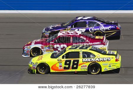FONTANA, CA - OCT 10:  Clint Bowyer, Matt Kenseth and Paul Menard fight for position during the Pepsi Max 400 race at the Auto Club Speedway in Fontana, CA on Oct 10, 2010.