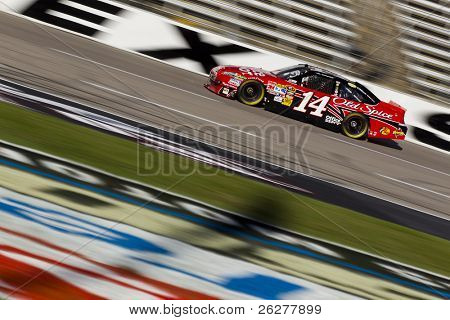 FORT WORTH, TX - NOV 06:  Tony Stewart (14) brings his race car through the frontstretch during practice for the AAA Texas 500 race on NOV 6, 2010 at the Texas Motor Speedway in Fort Worth, TX.