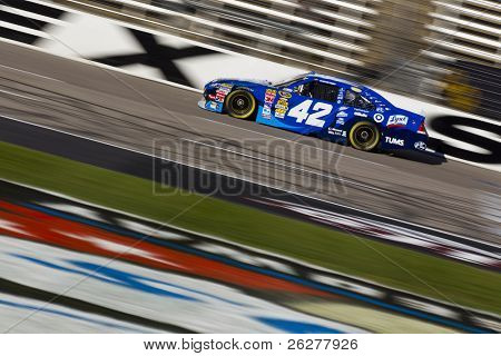 FORT WORTH, TX - NOV 06:  Juan Pablo Montoya car through the frontstretch during a practice session for the AAA Texas 500 race on Nov 6, 2010 at the Texas Motor Speedway in Fort Worth, TX.