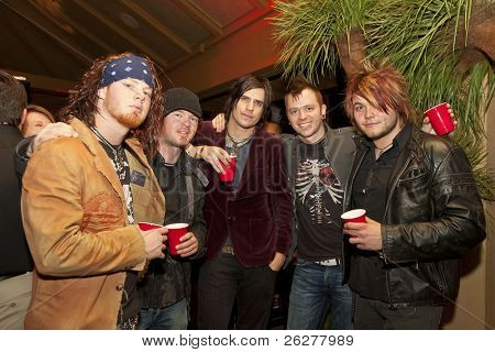 DAYTONA BEACH, FL - FEB 17: The rock group Hinder poses for a photograph before performing at the Chart House Restaurant on Feb 17, 2007 in Daytona Beach, FL.