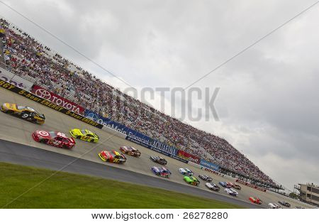 DOVER, DE - MAY 15:  The NASCAR Sprint Cup Series teams take for the FedEx 400 benefiting Autism Speaks race at the Dover International Speedway in Dover, DE on May 15, 2011.
