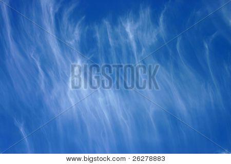 Whispy cloud and blue sky
