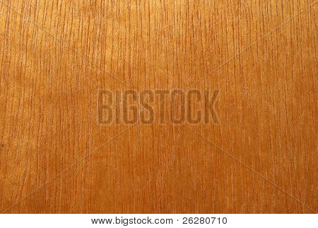 Abstract orange stained wood grain texture.