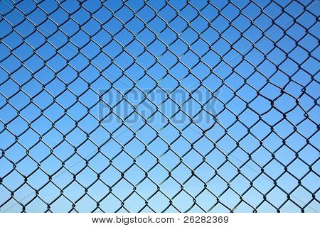 Chain link fence and a blue sky.