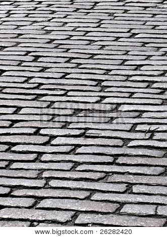Close up of cobbles in an old English cobblestone street in Truro, Cornwall UK.