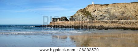 Panoramic view of Portreath pier and the Pepper Pot in Cornwall, UK.