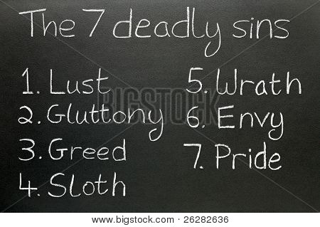 The seven deadly sins, written in chalk on a blackboard.