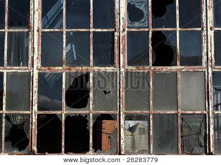 Close up of broken windows in a derelict building.