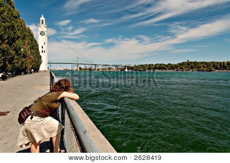 Woman Leaning On Rail Overlooking The St Lawrence River