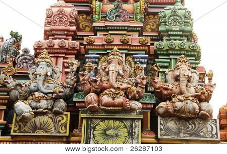 Detail of beautiful hindu temple with a Ganesha (elephant deity) statues isolated on white