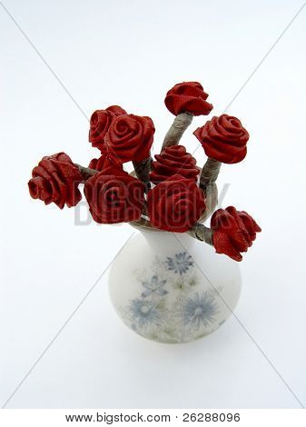 Red Roses in a vase and Isolated on white background
