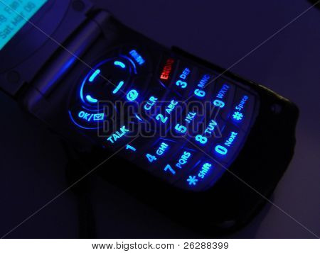 Closeup of cellular phone lite up in the dark