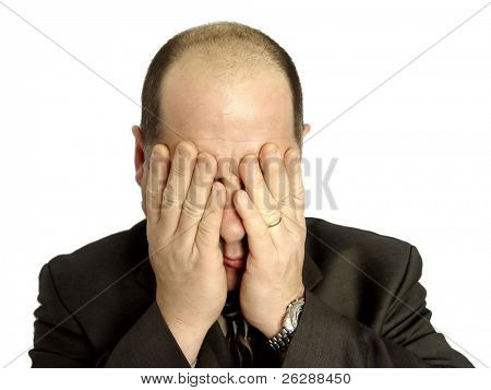 Businessman with hands over his face isolated on white background