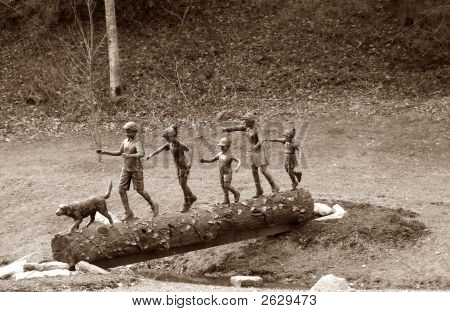Playful Children On Log