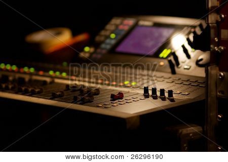 Soundboard mixer at a concert, shallow focus