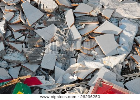 A pile of trash, various disposed, broken things
