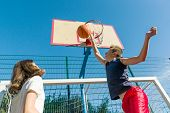 Streetball Basketball Game With Two Players, Teenagers Girl And Boy, Morning On Basketball Court. poster