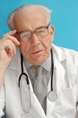 image of sounding-rod  - Portrait of senior family doctor with stethoscope - JPG